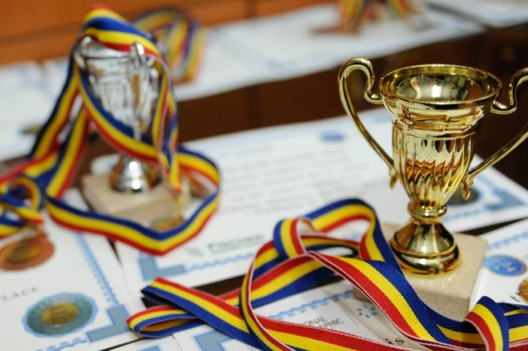 Bursa de merit pentru locul I la olimpiadele şcolare internaţionale, un salariul de bază minim brut