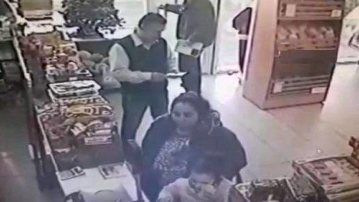 O femeie a furat bani de pe tejgheaua unui magazin